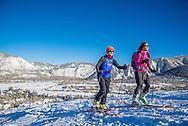 Skiers skin up Tiehack on Buttermilk Mountain in Aspen, Colorado.