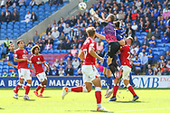 Bristol City goalkeeper Daniel Bentley (1) punches the ball clear from Cardiff City defender Sean Morrison (4) during the EFL Sky Bet Championship match between Cardiff City and Bristol City at the Cardiff City Stadium, Cardiff, Wales on 28 August 2021.