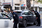 The outbreak of COVID-19 has forced governments around the world to impose a civil quarantine. The outcome of this are empty streets and public places. Police are questioning passengers in a car Photographed in Ibn Gabirol street, Tel Aviv, Israel on April 8th 2020