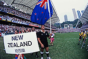 Jonah Lomu holds the New Zealand flag as he leads the All Blacks 7's squad onto the field.<br />  the 1996 Hong Kong 7's - World Rugby Sevens Series in Hong Kong held on 29th - 31st March 1996.<br /> Copyright photo: Andrew Cornaga / www.photosport.co.nz