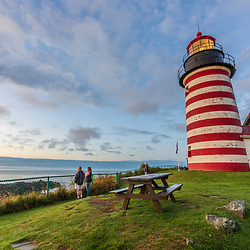 Visitors take in the view at West Quoddy Head Lighthouse in Lubec, Maine.