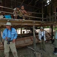 Tourists explore San Juan de Yanayacu village in Peru's Amazon Jungle.