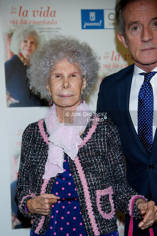 Spain's Duchess of Alba, Cayetana Fitz-James Stuart and her husband Alfonso Diez attend the presentation of her memories book 'What life has taught me' on Palacio de Cibeles on April 11, 2013 in Madrid