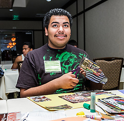 IRVINE, CA - MARCH 2: Student Marvin Muniz creates collages from magazines clips at the Treasure Room during the Working Wardrobes Dream Girls & Distinguished Gentlemen 2013 event at the Irvine Hilton in Irvine, CA. Working Wardrobes (http://www.workingwardrobes.org) is a non-profit organization located in Costa Mesa, CA. PHOTO: © 2013 SILVEX.PHOTOSHELTER.COM.