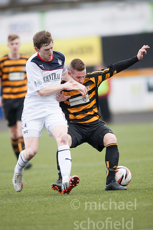 Falkirk's Blair Alston and Alloa Athletic's Andrew Kirk.<br /> half time : Alloa Athletic 0 v 0 Falkirk, Scottish Championship game played today at Alloa Athletic's home ground, Recreation Park.<br /> © Michael Schofield.