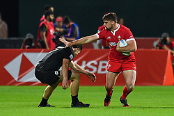 Ben Roach of Wales in action<br /> <br /> Photographer Craig Thomas/Replay Images<br /> <br /> World Rugby HSBC World Sevens Series - Day 1 - Thursday 5rd December 2019 - Sevens Stadium - Dubai<br /> <br /> World Copyright © Replay Images . All rights reserved. info@replayimages.co.uk - http://replayimages.co.uk