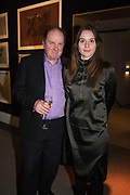 JIM NAUGHTIE AND HIS DAUGHTER FLORA NAUGHTIE, `preview evening  in support of The Eve Appeal, a charity dedicated to protecting women from gynaecological cancers. Bonhams Knightsbridge, Montpelier St. London. 29 April 2019