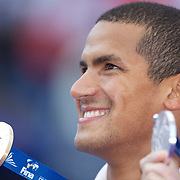 Oussama Mellouli of Tunisia displays his Gold medal to the media photographers after winning the Men's 1500m Freestyle at the World Swimming Championships in Rome, Italy on Sunday, August 2, 2009. Photo Tim Clayton.