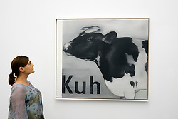 Woman looking at Gerhard Richter painting Kuh at Kuppersmuhle Museum in Duisburg Germany