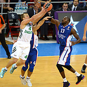 Anadolu Efes's Stephane Lasme (R) and Zalgiris Kaunas's Lukas  Lekavicius (L) during their Turkish Airlines Euroleague Basketball Group A Round 3 match Anadolu Efes between Zalgiris Kaunas at Abdi ipekci arena in Istanbul, Turkey, Thursday, October 30, 2014. Photo by Aykut AKICI/TURKPIX