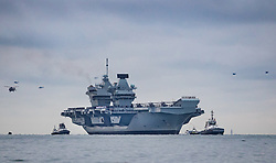 © Licensed to London News Pictures. 16/08/2017. Portsmouth, UK. The Royal Navy's new aircraft carrier HMS Queen Elizabeth arrives in The Solent before entering her home port of Portsmouth for the first time. The new ship at 65,000 tonnes is the biggest warship ever built in the UK. Photo credit: Peter Macdiarmid/LNP