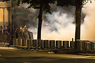A plume of tear gas is blown back towards Federal authorities at the Federal Courthouse in downtown Portland, Oregon.