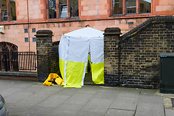 A Tent marks the spot where paramedics performed CPR outside Cardinal Vaughan School in an attempt to save the life of a man at 29 Holland Park Gardens after a fire in a flat on the first floor of a converted house claims the life of a man and his dog in Holland Park, West London. February 07 2018.