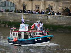© Licensed to London News Pictures. 15/06/2016. London, UK. A Vote Leave boat passes the MP's terrace as EU remain and vote leave campaigners converge on the Thames near Parliament. Photo credit: Peter Macdiarmid/LNP