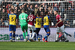 West Ham United's Marko Arnautovic scores his side's second goal during the Premier League match at the London Stadium.