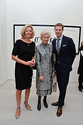 Left to right, JULIA OGILVY, HRH PRINCESS ALEXANDRA and JAMES OGILVY at a private view of photographs by wildlife photographer David Yarrow included in his book 'Encounter' held at The Saatchi Gallery, Duke of York's HQ, King's Road, London on 13th November 2013.
