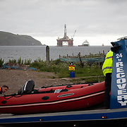 Greenpeace activists board a BP oil rig in Cromarty Firth to stop it from further oil drilling at sea, June 10th 2019, Cromarty, Scotland, United Kingdom. The oil rig 'Paul B. Loyd, Jnr', owned by Transocean, was due to head to BP's Vorlich field, 150 miles (241km) east of Aberdeen to drill for oil for BP. A Greenpeace rhib is taken away. The occupation by Greenpeace activists subsequently delayed the departure for 5 days and 14 activists were arrested in the process. Greenpeace says that in an age of climate emergency BP should not be drilling for new oil but look for non-fossil fuel means of energy.