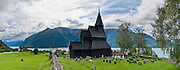 Urnes stavkirke (or stavkyrkje), the oldest Stave Church in Norway, stands at Ornes farm on Lustrafjord in Luster municipality, Sogn og Fjordane county, Norway. The church was built around 1135 AD and links Christian architecture with animal-ornamentation of the Viking Age. In 1979, Urnes Stave Church was listed as a World Heritage Site by UNESCO. Fortidsminneforeningen (Society for the Preservation of Norwegian Ancient Monuments) has owned it since 1881. Panorama stitched from 3 overlapping photos.