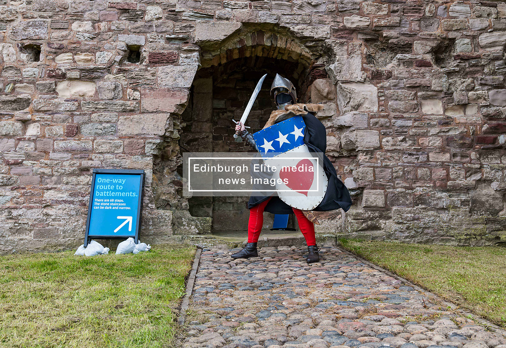 North Berwick, East Lothian, Scotland, UK, Tantallon Castle reopening: Historic Environment Scotland reopens more of their properties today including this 14th century Medieval curtain wall clifftop castle which overlooks the Firth of Forth. Andrew Spratt, HES custodian and Medieval enthusiast welcomes the first visitors, dressed appropriately as a knight in Medieval armour with a face mask. <br /> Sally Anderson   EdinburghElitemedia.co.uk