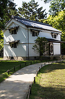 Kura are traditional Japanese storehouses - they are durable buildings built of stone or clay  and were once used to store valuables safely. <br /> Typically they were fireproof with a clay outer coating. Kura used to store gunpowder were constructed from stone.