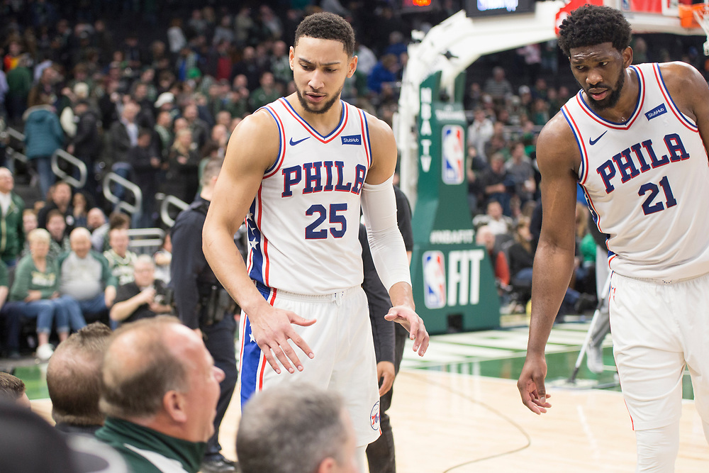 Ben Simmons and Joel Embiid exchange words with a fan during the Philadelphia 76ers' away game against the Milwaukee Bucks on March 17, 2019.