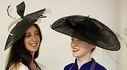 © Licensed to London News Pictures. 25/06/2012. LONDON, UK. Two members of staff at Kerry Taylor Auctions models hats previously worn by Kate Middleton. (L - on the occasion of H.R.H. Prince William being awarded the Order of the Garter est £1,000 - 1,500) (L on the occasion of the wedding of Harry Meade in the company of H.R.H. Prince William est £1,000 - 1,500). The hats are being sold as part of an auction of over 250 lots of fine haute couture, accessories and textiles. Photo credit: Matt Cetti-Roberts/LNP