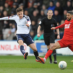 TELFORD COPYRIGHT MIKE SHERIDAN 23/3/2019 - Ryan Barnett of AFC Telford (on loan from Shrewsbury Town Football Club) shoots under pressure from Jobi McAnuff (captain) of Orient during the FA Trophy Semi Final fixture between AFC Telford United and Leyton Orient at the New Bucks Head