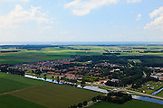 Nederland, Noordoostpolder, 30-06-2011; Uiterdijkenweg (ten noordoosten van Luttelgeest). De Noordoostpolder (NOP), is een voorbeeld van moderne grootschalige polder met rationele verkaveling. De aanleg van de polder maakte  deel uit van de Zuiderzeewerken (plan Lely) en viel in 1942 droog. De meeste boerderijen (en dorpen) zijn van na de tweede wereldoorlog..The northeast polder (NOP), is an example of modern large-scale polder with rational allotment. The construction of the polder was part of the Zuiderzee Works (Lely plan), in 1942 the polder was dry. Most of the building, farmhouses and villages, is post-war..luchtfoto (toeslag), aerial photo (additional fee required).copyright foto/photo Siebe Swart