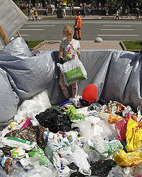 May 26, 2019 - Kiev, Kiev, Ukraine - A little girl seen in garbage from plastic bags placed by eco activists outside the Kiev City Hall, during the protest..An environmental group activists organized a 'March of plastic bags' outside the Kiev City Hall in Kiev, Ukraine. The activists demand to solve the problem of using and processing of polyethylene bags and other plastic packaging and impose restrictions on use of plastic bags in the capital and the country. (Credit Image: © Pavlo Gonchar/SOPA Images via ZUMA Wire)