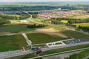 Nederland, Overijssel, Gemeente Kampen, 27-08-2013. Hanzelijn met Station Kampen Zuid, stadsdeel Kampen-Zuid. IJssel in de achtergrond. Parallel aan de spoorlijn de N50. Ontwerp van architect Tjerk van de Lune (StudioSK). <br /> Railway station at the new railway Hanzelijn, near Kampen.<br /> luchtfoto (toeslag op standaard tarieven);<br /> aerial photo (additional fee required);<br /> copyright foto/photo Siebe Swart.