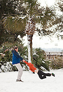 CHARLESTON, SC - February 13: A father spins his son in the snow February 13, 2010 during a rare snow storm in Mt Pleasant, SC. About 3-inches of snow fell on the Charleston area, the first significant snow in 20-years.    (Photo Richard Ellis/Getty Images)