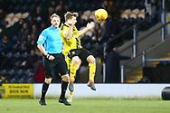 Burton Albion midfielder Jamie Allen (4) gets in a header during the EFL Sky Bet League 1 match between Burton Albion and Bradford City at the Pirelli Stadium, Burton upon Trent, England on 26 January 2019.