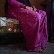 Mamta Pandey sits on chests that hold her old knitting and cross stitch work from years before she joined the women's knitting circle, in her home 20km from Ranikhet, India on Dec. 6, 2018.