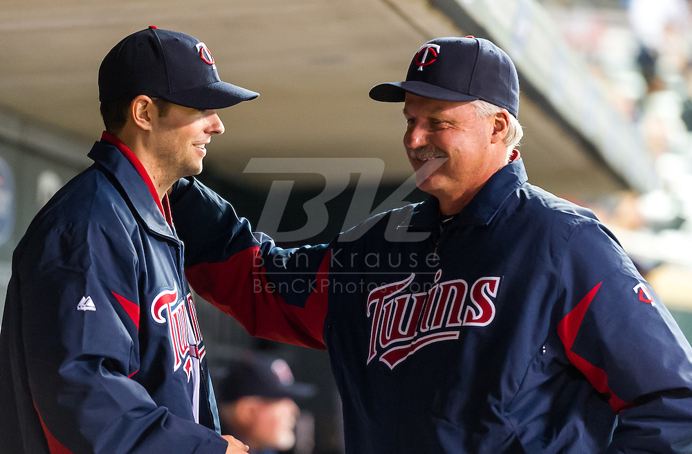Minnesota Twins starter Scott Diamond is congratulared by pitching coach Rick Anderson after Diamond pitched 7 shutout innings against the Los Angeles Angels on May 8, 2012 at Target Field in Minneapolis, Minnesota.  The Twins defeated the Angels 5 to 0. © 2012 Ben Krause