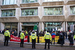 London, UK. 22nd January, 2019. Receptionists, security guards and cleaners at the Ministry of Justice (MoJ) represented by the United Voices of the World (UVW) trade union stand on the picket line after beginning a strike for the London Living Wage of £10.55 per hour and parity of sick pay and annual leave allowance with civil servants. The strike is being coordinated with support staff at the Department for Business, Energy and Industrial Strategy (BEIS) from the Public and Commercial Services (PCS) union.