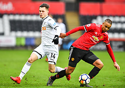 Cameron Boothwich-Jackson of Manchester United under pressure from Liam Cullen of Swansea City - Mandatory by-line: Craig Thomas/Replay images - 18/03/2018 - FOOTBALL - Liberty Stadium - Swansea, England - Swansea City U23 v Manchester United U23 - Premier League 2 - Divison 1