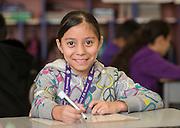 Prisila Gutierrez poses for a photograph at Herrera Elementary School, February 13, 2015.