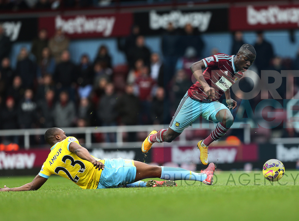 West Ham's Enner Valencia tussles with Crystal Palace's Shola Ameobi<br /> <br /> Barclays Premier League - West Ham United  vs Crystal Palace  - Upton Park - England - 28th February 2015 - Picture David Klein/Sportimage