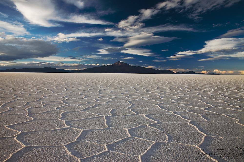 Salt hexagon patterns and Volcano Tunupa on the Salar de Uyuni,  Bolivia,South America
