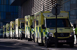 © Licensed to London News Pictures.25/01/2021, London,UK. Ambulances are lined up at the Royal London Hospital in east London as the third national lockdown continues and hospitals are struggling to cope with the number of admissions. Photo credit: Marcin Nowak/LNP