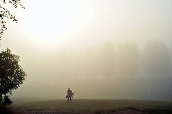 © Licensed to London News Pictures. 23/10/2016<br /> Foggy morning in Kent.<br /> Cray Valley Golf Club golfers in Orpington,Kent play golf in the autumn fog.<br /> <br /> Photo credit :Grant Falvey/LNP