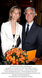 SIR RONALD & LADY COHEN at a reception in London on 24th April 2003.PJA 54