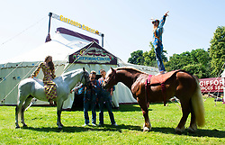 """Giffords Circus presents """"Xanadu"""" <br /> Produced by Nell Gifford  - Directed by Cal McCrystal<br /> At Chisiwck House and Park, London, Great Britain <br /> Press view <br /> 27th June 2019 <br /> <br /> 7th and 8th generation horse-people The Donnert Family from hungry performing in the UK for the first time at Giffords Circus<br /> <br /> <br /> Roll up, roll in to the stately pleasure-dome for miracles, song, symphony and enchantment. Musicians, horses, clowns and tumblers enfolded in this joyful paradise, with music loud and long - the Giffords Circus caravan will be taking to the road for a 2019 summer of love.<br /> <br /> <br /> It is midsummer 1973 in Hyde Park and the flower power movement is at its height. Hippies, hipsters, rock stars, musicians, wild women and global nomads with Shamanic horses gather to play, sing, dance, protest and perform. Policemen and a family of out-of-towners get caught up in the celebrations. Will they get in the groove? Nell Gifford builds a pleasure dome and Tweedy has a job in the kitchen as he thought everyone was talking about """"Flour Power"""". As evening approaches, the ever more chaotic event careers towards a joyful, transcendental finale. <br /> <br /> Photograph by Elliott Franks"""