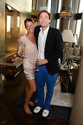 An exclusive preview of the new Samsung OLED Curved TV has hosted by Nick & Holly Candy at their home at One Hyde Park, London on 29th August 2013.<br /> Picture shows:-Dan Philipson and Olivia Meyrick
