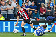 Sheffield United midfielder Paul Coutts (15) beats a tackle from Sheffield Wednesday midfielder Ross Wallace (33)    during the EFL Sky Bet Championship match between Sheffield Wednesday and Sheffield Utd at Hillsborough, Sheffield, England on 24 September 2017. Photo by Phil Duncan.