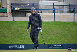 Ruud Gullit reacts after teeing off at the 1st hole during day three of the Alfred Dunhill Links Championship at The Old Course, St Andrews.