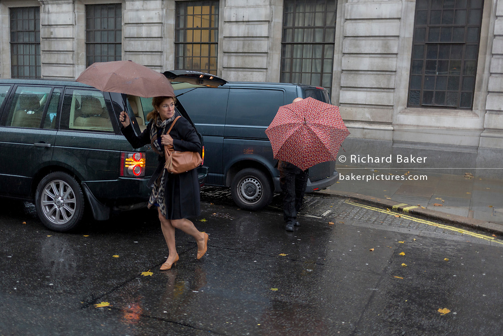 Londoners and visitors to the capital endure heavy rainfall on an autumn afternoon near Trafalgar Square, on 24th October 2019, in Westminster, London, England.