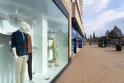 Edinburgh, Scotland, UK. 24 March, 2020.  Princes Street which is Edinburgh's main shopping street is very quiet. All shops and restaurants are closed with very few people venturing outside following the Government imposed lockdown today. Iain Masterton/Alamy Live News