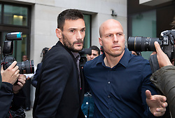 © Licensed to London News Pictures. 12/09/2018. London, UK. Tottenham Hotspur Captain and French international goalkeeper Hugo Lloris (L) leaves Westminster Magistrates Court after pleading guilty to drink driving after he was stopped by police on 24 August. Photo credit: Peter Macdiarmid/LNP