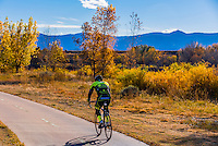 People riding bikes along the extensive bike trail system in Littleton, Colorado USA.